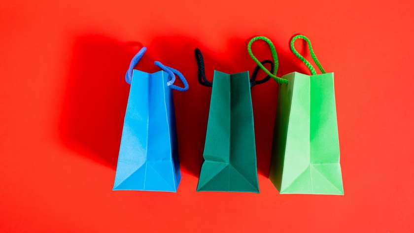 What benefits do compostable paper bags have for the environment